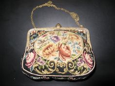 Handmade tapestry bag original from the 20s...with a beautiful ornate bracket...