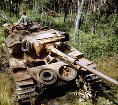 A Centurion tank awaits assistance as it sits bogged in the muddy ground near the May Tao Mountains