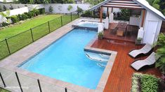 L-shaped pool and spa with timber decking and a pergola. Photo courtesy of Performance Pool & Spa