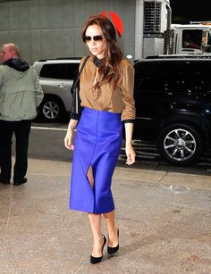 Pin for Later: Victoria Beckham's Go-To Summer Styling Trick Is Straight Up Genius  Wearing a bright purple skirt from her own line in May 2013.