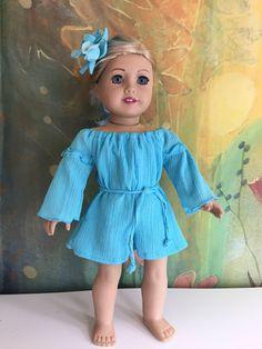 A personal favorite from my Etsy shop https://www.etsy.com/listing/512394150/american-girl-blue-hawaii-romper-set