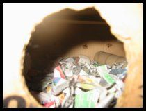 DIY ferret toy - Stuff box - shredded paper, old t-shirts, etc. in a cardboard box with a hole cut out