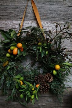 Fresh citrus kumquats for a cheery orange and green holiday wreath. 18 Breathtaking Christmas Door Wreaths That Are Begging To Be Stolen By Neighbors — DESIGNED w/ Carla Aston Noel Christmas, Winter Christmas, All Things Christmas, Christmas Crafts, Christmas Decorations, Natural Christmas, Elegant Christmas, Victorian Christmas, Christmas Images