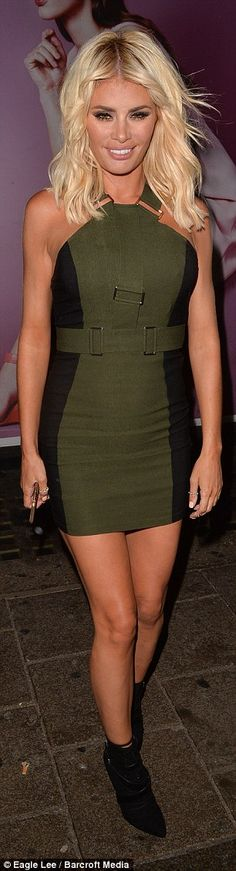 Blonde beauty: She worked a slight military theme as she paired the dress with a leather j...