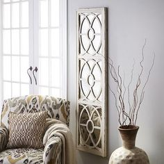 Our classic wall panel doesn't just fill an empty space. The mirrored back makes your room feel bigger, while the weathered wooden frame and patterned overlay add texture and interest. It's begging for a second (or third) glance. Living Room Windows, Home Living Room, Living Area, Empty Wall Spaces, Bedroom Decor, Wall Decor, Wall Art, Kitchen Sink Window, Wide Plank Flooring
