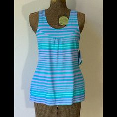 Brand new Columbia omni- shade and omni-wick tank. Very cute Columbia tank top. Omni - shade technology offering upf 50. Omni wick technology as well.  Women's size small.  92% polyester and 8% elastane. Light teal and purple. New with tags. Columbia Tops Tank Tops