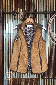 The Jozye - Quilted faux suede vest. Saddle tan faux suede outter. Herringbone yoke and collar accents. Leopard lined.