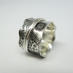 Vintage Inspired Paisley Sterling Silver Spinner Ring with Two Stering Silver Spinners. Janiceartjewelry, via Etsy.
