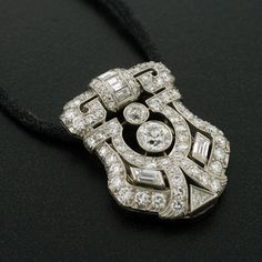 This gorgeous diamond pendant from the Art Deco era hangs from its original black cord and makes a stunning statement!