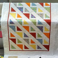 Kathe is very excited to welcome her first grandchild this fall and wasted no time picking out the perfect first quilt.  The fabrics she sel...