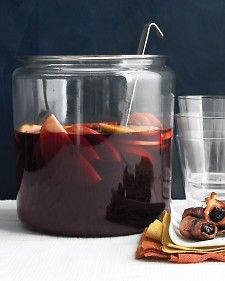 Red Sangria - Martha Stewart Recipes    Ingredients     1 cup brandy   1 orange (ends cut off), thinly sliced   1 red apple, halved and thinly sliced   2 bottles well-chilled dry red wine, such as Rioja or red Zinfandel   1 cup club soda   3/4 cup fresh orange juice       Directions    1. In a large pitcher, stir together brandy, orange and apple slices. Let stand 15 minutes. Add wine, club soda, and orange juice. Serve over ice.  serves 8