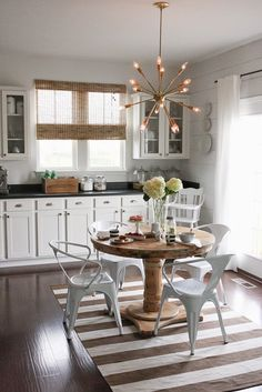 Modern sputnik chandelier mixes with traditional kitchen furniture eclecticallyvintage.com
