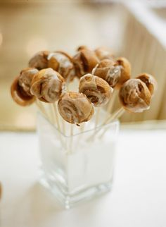 "Alea's pick for Wedding & Party Foods! Mini Cinnamon Buns on a Stick. Great Idea to eliminate the ""Sticky Fingers"" from eating a Cinnamon Bun..."