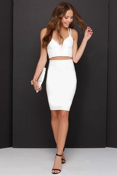 "Lulus Exclusive! Playful but still with undeniable chicness, the Class and Sass Ivory Two-Piece Dress is a must-have! A stretch knit fabric constructs a fitted, princess seamed bodice, with enticing strappy back, and cropped hem. Matching high-waisted bodycon pencil skirt has a hidden zipper at back. Small top measures 14"" long. Small bottom measures 22"" long."