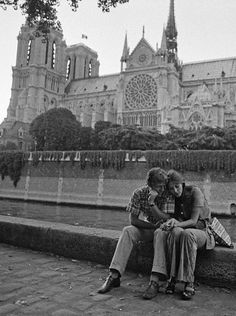A couple embraces in front of the Notre Dame, Ile-de-France, 1970