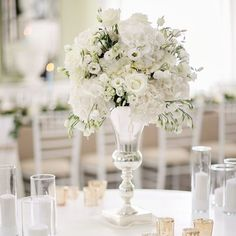 •INSPIRATION• The total white #weddingtheme is the most elegant, classy and chic of all (also my favorite!). Gorgeous white flower #centerpiece by @tymephotography, designed perfectly by @whiteribbonevents from the beautiful #santoriniwedding…