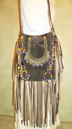 The body of this bag is made from a DEEP Chocolate Genuine Suede skirt. An oval suede base 2 wide holds the shape of the bag and gives more inside storage. A vibrant colored statement necklace dresses the front of the bag. Gypsy Bag, Hippie Gypsy, Fringe Purse, Fringe Bags, Hippie Purse, Leather Crafting, Handmade Purses, Suede Skirt, Body Bag