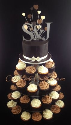 Chocolate cupcake tower, would be cute to incorporate some chocolate, that you or your girls make for her...