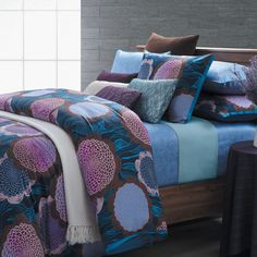 Fantasy 7-piece Duvet Cover Set | This bold Fantasy duvet cover set from EverRouge is young and expressive. Dress up your bedroom decor with this cotton made seven-piece floral designed duvet cover set.   Set includes: One (1) duvet cover, two (2) shams, two (2) euro shams, two (2) accent pillows with removable covers Accents pillows: Purple stripes and sequined aqua  Overstock.com $98
