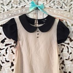 Black & White Silk Peter Pan Collar Blouse M This cream silk top features a black Peter Pan collar and short sleeves, as well as a row of black buttons. Size Medium, from Forever 21. Used, but in great condition! Forever 21 Tops Blouses