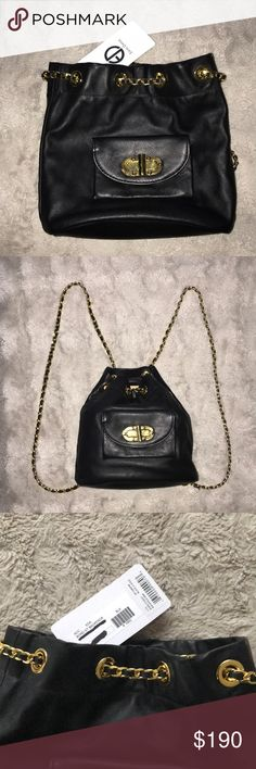 Black backpack A miniature Erin Dana backpack, styled in chic leather with polished hardware. A turn-lock closure details the front flap pocket. An interwoven chain draws the top closed and fits around the shoulders. Lined, single-pocket interior. *New and never used* Erin Dana Bags Backpacks