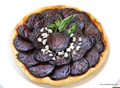 Roasted Beet Tarte Tatin with Walnuts, Goat Cheese, and Feta is a fab showstopper for holiday parties. Bakes in only 35 minutes. #holidayeats #kwanzaa #hanukkah #christmas #newyear #baking #tarts #pastries #beet #partyrecipes #easyrecipes #chefmode #cheese #foodie #yummy #delicious #beautiful
