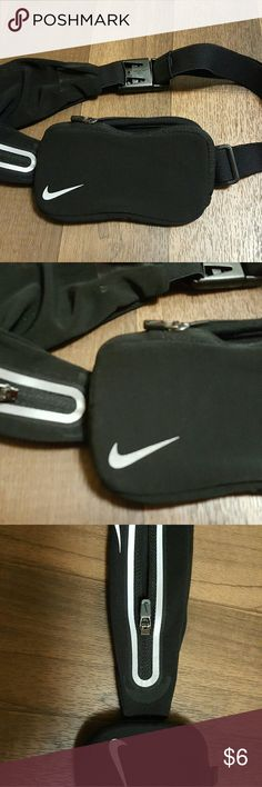 New NIKE Exercise Carrying Case Belt Adjustable belt has phone size pouch zip and and additional smaller side zip pocket. Elastic and adjustable straps. Clip closure. Nike. New Nike Accessories