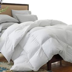 Polyester down-blend comforter in white.      Product: Comforter    Construction Material: White down and polyest...