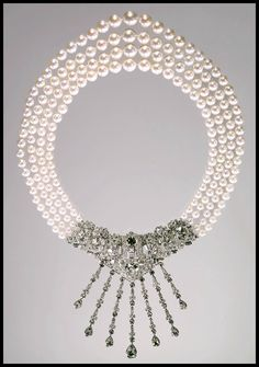 The 1963 Cartier three-strand Caro Yamaoka pearl necklace worn by Marjorie Merriweather Post in a photograph. Image: Courtesy Hillwood Estate, Museum and Gardens. Cartier Jewelry, Pearl Jewelry, Antique Jewelry, Pearl Necklace, Vintage Jewelry, Cartier Necklace, Gold Necklaces, Art Deco Jewelry, Modern Jewelry