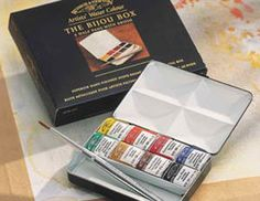 Winsor & Newton Artists' Watercolor Paint Set: Bijou Box, 8-Color Set, Half Pans Plus Brush.  This box will hold 14 half pans and is great for travel journaling.