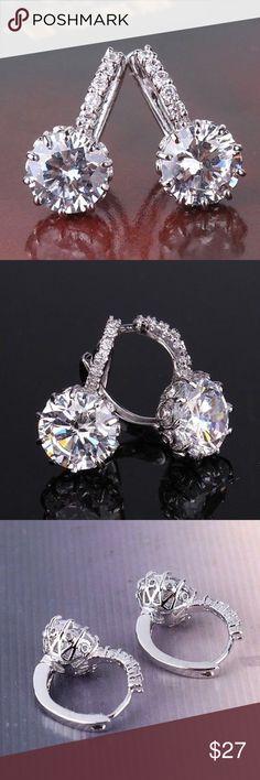 18k white gold filled earrings Brand new. Comes in box. white sapphire leverback 18k white gold filled earring Jewelry Earrings