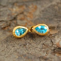 Gold and Blue Topaz Gemstone Tear drop stud Earring - 18k Gold.