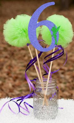 This listing is for a custom centerpiece. You will receive:  1 number stick made from glittery purple card stock and adorned with a glittery green