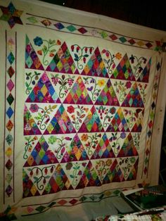 """""""Daddy's Quilt"""", made while traveling back and forth to visit dad 2014-15. Center of quilt is Sweet Surrender designed by Susanne Cody, Australia. The border is my design"""