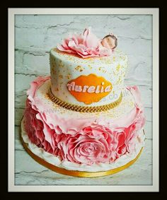 2 tier chocolate cake with handmade edible baby topper