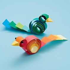Crafts from scraps - colorful birds made from loops of scrap paper