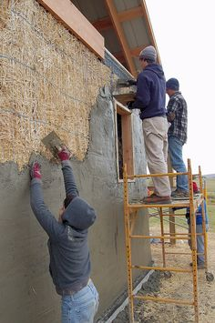 Ellensburg straw bale construction plastering workshop barn raising, plastering up higher on the west wall