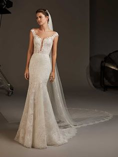 Dancing Lights: The new Pronovias 2020 collection we& been waiting for is here! - Pronovias Wedding Dresses The collection we were eagerly waiting for is here! Evening Dresses For Weddings, Designer Wedding Dresses, Bridal Dresses, Bridesmaid Dresses, Pronovias Wedding Dress, Lace Mermaid Wedding Dress, Wedding Gowns, Wedding Suite, Fit And Flare Rock