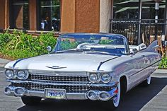 '59 Cadillac Convertible... Big Style. Doesn't handle, but you'l sure look cool understeering around those corners!