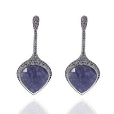 Live From Baselworld 2014: Monastery earrings in 18k gold with 39.74 cts. t.w. tanzanite and 1.01 cts. t.w. lavender spinel, $14,000; Carla Amorim
