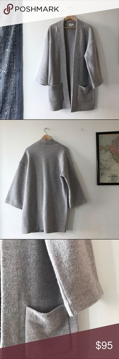 Wilfred Brullon Sweater in Heather Light Gray Amazing structured open cardigan from Aritzia's Wilfred brand. Made with soft and warm merino wool. Oversized silhouette that is relaxed. Two front pockets and 3/4 length sleeves. Worn a handful of times, in good used condition wth some pilling. Aritzia Sweaters Cardigans