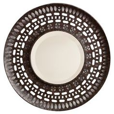 "Distressed metal wall mirror with openwork frame.  Product: Wall mirrorConstruction Material: Metal and mirrored glassColor: BrownDimensions: 23.75"" Diameter"
