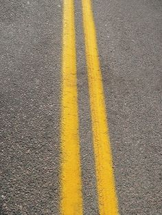The solid lines in the street is an example of parallel lines