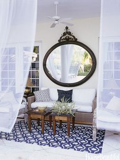 Porch Decorating Ideas - Summer Porch Decor - House Beautiful The mirror is a nice touch. Makes it all look bigger. Outdoor Rooms, Outdoor Living, Outdoor Patios, Outdoor Kitchens, Outdoor Lounge, Outdoor Seating, Outdoor Furniture, Ideas Para Decorar Jardines, Summer Porch Decor