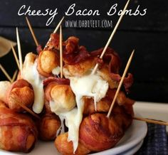 Cheesy Bacon Bombs - 1 can Pillsbury Grands Flaky Layers Biscuits, Cubed Mozzarella, 2 lbs. Bacon slice per Bomb), Sticks, Oil for frying. I'm not a big bacon fan but these look AMAZING. Bacon Recipes, Appetizer Recipes, Cooking Recipes, Bacon Appetizers, Party Appetizers, Picnic Recipes, Picnic Ideas, Picnic Foods, Grilling Recipes