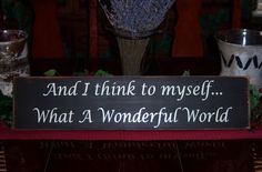 And I Think To Myself, What A Wonderful World Distressed Hand Painted Wood Sign. $25.00, via Etsy.