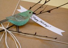 Take brown craft paper and spice it up with seasonal embellishments like twigs, twine, and a cut-out bird image.