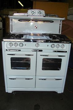 Color appliances are nice to look at but the original white is the most beautiful for antique stoves, in my opinion, and is what I own myself.