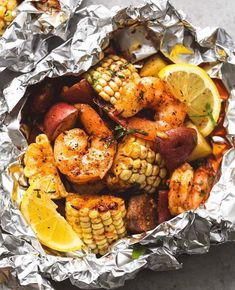 Easy, tasty shrimp boil foil packs baked or grilled with summer veggies, homemade seasoning, fresh lemon, and brown butter sauce. The BEST and easiest way to make shrimp boil at home! Easy Fish Recipes, Healthy Recipes, Cooking Recipes, Whole30 Recipes, Healthy Desserts, Crockpot Recipes, Smoker Recipes, Meal Recipes, Healthy Meals