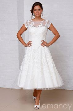 Tea-length short sleeves scoop princess organza with lace applique wedding dress. $199.00, via Etsy.